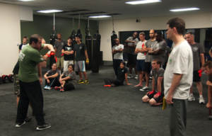 Students learning applicable self defense moves